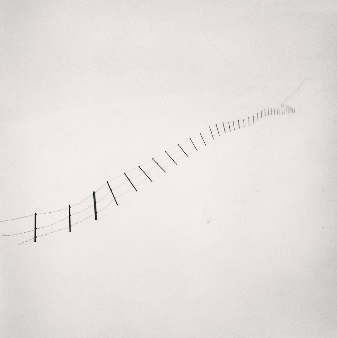 Hillside Fence, Study 4, Teshikaga, Hokkaido, Japan - Michael Kenna